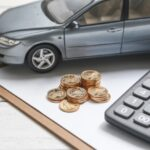 car model, calculator, and coins